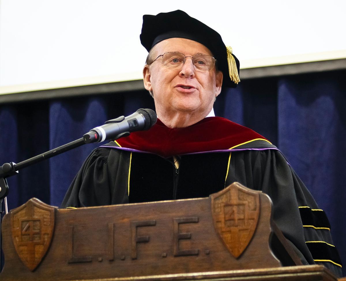 Dick Scott speaking at a graduation event.