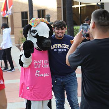 Future LPU Students posing with Chik fil a mascot